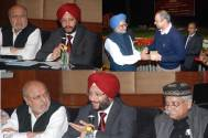 Prime Minister Manmohan Singh attends a special screening of Shyam Benegal