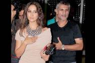 Is Kim Sharma cheating on her hubby with designer Arjun Khanna?
