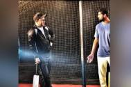 Virender Sehwag gives cricket tips to Tanuj Virwani