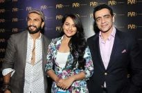 Mr. Ajay Bijli, CMD, PVR Ltd. opens the PVR multiplex at Phoenix Marketcity, Bangalore, along with renowned actors Ranveer Singh