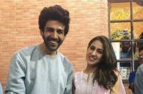 Sara Ali Khan trips and almost falls off stage; Kartik Aaryan saves her