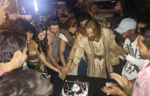 Porus team calls for a celebration on hitting a century!