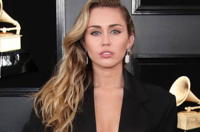 Why was Miley not invited to the Grammy Awards?