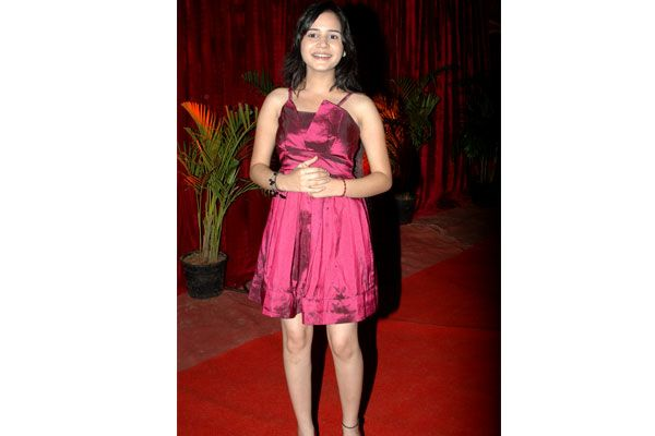 Shivsakti 'laadli Bebo' Sachdeva  attempts to dress her real age in this maroon silk knee-length dress and the cute little thing does look fresh as a daisy. Though we think she could have gone for a funky hair do.