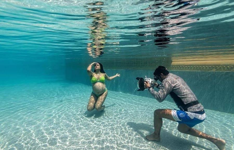Sameera Reddy flaunts baby bump in underwater photoshoot